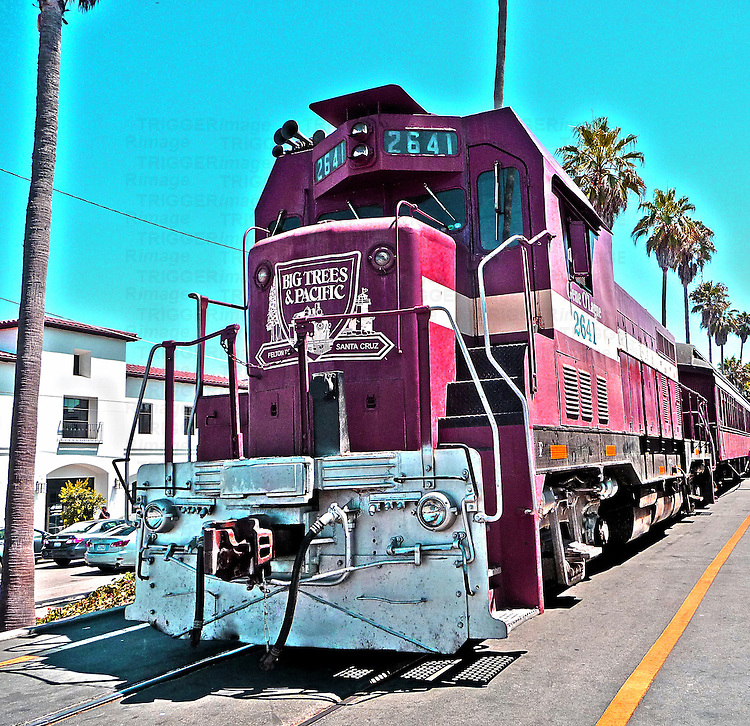 Diesel train in USA with palm trees
