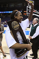 31 March 2008: Candice Wiggins holds the regional championship trophy after Stanford's 98-87 win over the University of Maryland in the elite eight game of the NCAA Division 1 Women's Basketball Championship in Spokane, WA.