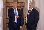 United States President-elect Donald Trump (L) gestures with retired US Marine Corp General John Kelly at the clubhouse of Trump International Golf Club, in Bedminster Township, New Jersey, USA, 20 November 2016.<br /> Credit: Peter Foley / Pool via CNP