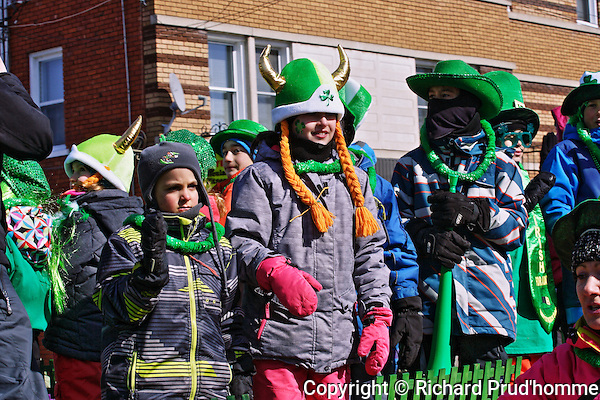 Kids dressed in green on one of the floats of the St. Patricks parade in Rawdon, quebec