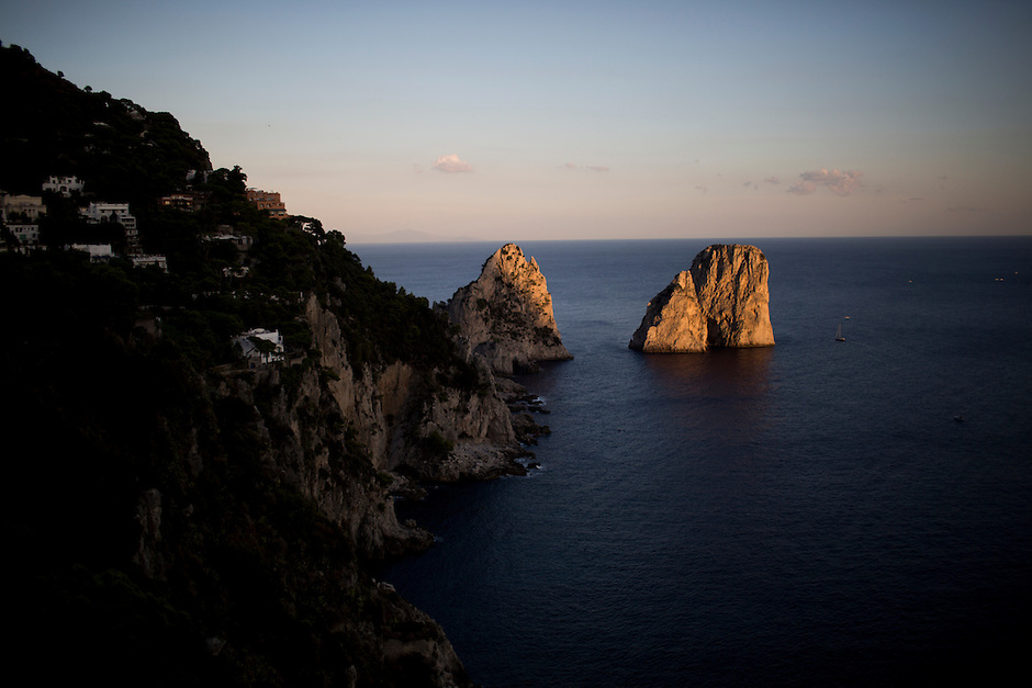 The Faraglione di Fuori is illuminated by the sunset on Monday, Sept. 21, 2015, off the island of Capri in Italy. (Photo by James Brosher)