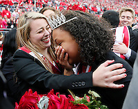 Chasmine Anderson, left, is congratulated by other nominees named the 2014 Homecoming Queen before Saturday's NCAA Division I football game between the Ohio State Buckeyes and the Rutgers Scarlet Knights at Ohio Stadium in Columbus on Saturday, Oct. 18, 2014. (Dispatch Photo by Barbara J. Perenic)