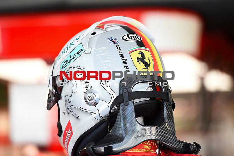 28.04.2017, Sochi Autodrom, Sochi, FORMULA 1 VTB RUSSIAN GRAND PRIX,  28.04. - 30.04.2017<br /> Sebastian Vettel (GER#5), Scuderia Ferrari tr&auml;gt am Helm einen Aufkleber f&uuml;r den verunfallten englischen Formel 4 Fahrer Billy Mogler, Spitzname Billy Whizz<br /> <br /> <br /> <br /> Foto &copy; nordphoto / Bratic