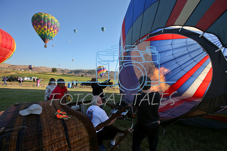 Pilot Bob Raper gets his balloon ready to fly on media day of the 32nd annual Great Reno Balloon Race in Reno, Nev., on Thursday, Sept. 5, 2013.  <br /> Photo by Cathleen Allison