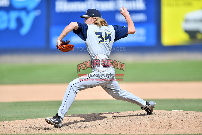 Columbia Fireflies pitcher Christian Tripp (34) delivers a pitch during a game against the Asheville Tourists at McCormick Field on June 23, 2019 in Asheville, North Carolina. The Fireflies defeated the Tourists 11-9. (Tony Farlow/Four Seam Images)