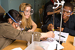Education high school science group working on experiment