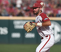 NWA Democrat-Gazette/J.T. WAMPLER Arkansas' Jack Kenley fields a hit by Ole Miss Monday June 10, 2019 during the NCAA Fayetteville Super Regional at Baum-Walker Stadium in Fayetteville. Arkansas won 14-1 and will advance to the College World Series in Omaha.