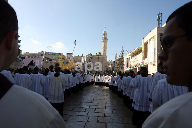 Clergy gather in Manger Square outside the Church of the Nativity while Christians gather for Christmas celebrations in the West Bank city of Bethlehem, on December 24, 2010, as thousands of Christian pilgrims descended on on the holy city to celebrate in Jesus' traditional birthplace. Photo by Issam Rimawi