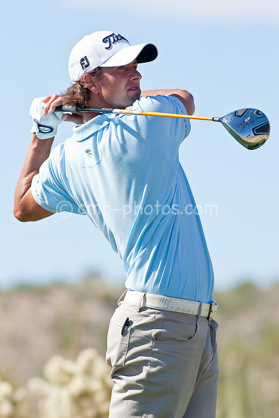 Feb 25, 2009; Marana, AZ, USA; Adam Scott (AUS) hits his tee shot on the 13th hole during the first round of the World Golf Championships-Accenture Match Play Championship at the Ritz-Carlton Golf Club, Dove Mountain.