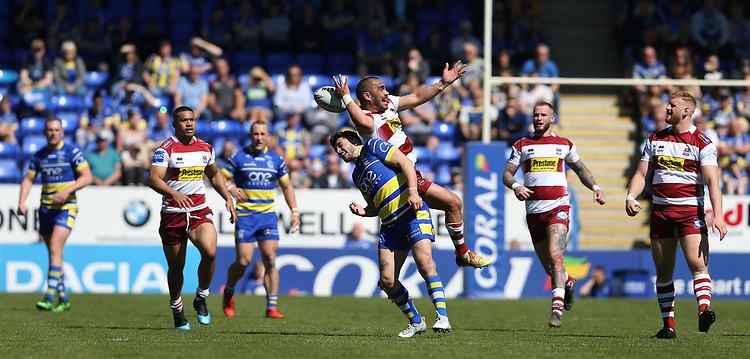Wigan Warriors' Thomas Leuluai and Warrington Wolves' Declan Patton compete for a high ball <br /> <br /> Photographer Stephen White/CameraSport<br /> <br /> Rugby League - Coral Challenge Cup Sixth Round - Warrington Wolves v Wigan Warriors - Sunday 12th May 2019 - Halliwell Jones Stadium - Warrington<br /> <br /> World Copyright © 2019 CameraSport. All rights reserved. 43 Linden Ave. Countesthorpe. Leicester. England. LE8 5PG - Tel: +44 (0) 116 277 4147 - admin@camerasport.com - www.camerasport.com