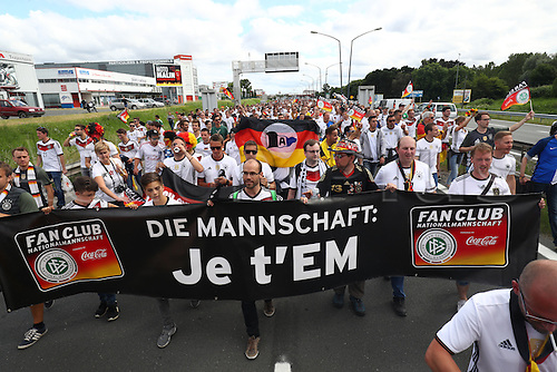 "02.07.2016. Bordeaux, France.  Supporters of Germany take part in the so-called ""Fan-Walk"" prior to the UEFA EURO 2016 quarter final soccer match between Germany and Italy at the Stade de Bordeaux in Bordeaux, France, 02 July 2016."