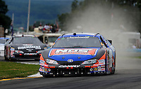 Aug. 8, 2009; Watkins Glen, NY, USA; NASCAR Nationwide Series driver Kyle Busch (18) during the Zippo 200 at Watkins Glen International. Mandatory Credit: Mark J. Rebilas-
