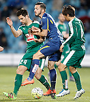 Getafe's Pablo Sarabia (c) and Sociedad Deportiva Eibar's Adrian Gonzalez (l) and Takashi Inui during La Liga match. March 18,2016. (ALTERPHOTOS/Acero)