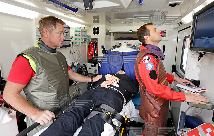 "Simualtion  with ambulance fitted with a CT scanner, a so called ""stroke ambulance"", with paramedics in Sarpsborg, Norway. Part of   research project by  Chief medical adviser Dr. Thomas Lindner (right) and PhD candidate Maren Ranhoff (not in picture) , Norwegian Air Ambulance Foundation."