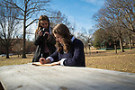 Senior Journalism and English majors Hannah Hurdle, with camera, and Natalie Seales work on a project for their Journalism 500 class.  Photo by Kevin Bain/University Communications Photography