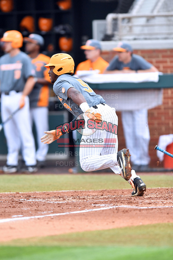 Tennessee Volunteers right fielder Justin Ammons (9) runs to first base during a game against the University of North Carolina Greensboro (UNCG) Spartans at Lindsey Nelson Stadium on February 24, 2018 in Knoxville, Tennessee. The Volunteers defeated Spartans 11-4. (Tony Farlow/Four Seam Images)