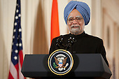 Washington, DC - November 24, 2009 -- Manmohan Singh, India's prime minister, speaks during a news conference with U.S. President Barack Obama in the East Room of the White House in Washington, D.C., U.S., on Tuesday, November 24, 2009. Singh was welcomed to the White House this morning by Obama for a state visit where the two leaders will have discussions on curbing nuclear weapons, climate change and trade. .Credit: Andrew Harrer - Pool via CNP