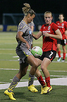 Philadelphia forward, Lianne Sanderson (10), traps the ball as Atlanta defender, Leigh Ann Robinson (7) looks on.  Atlanta and Philadelphia played to a 0-0 draw in the season opener for both teams at John A Farrell Stadium in West Chester, PA.