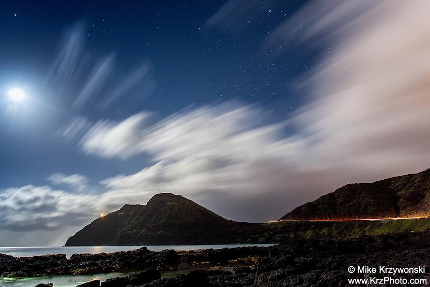 View of Ko'olau mountain range & tidal pools under a full moon at night, Makapu'u Beach, Waimanalo, Oahu