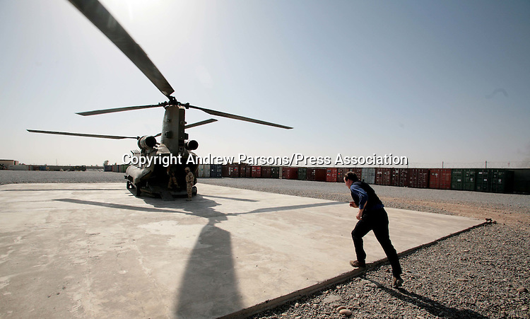 Prime Minister David Cameron runs towards a Chinnock helicopter after meeting troops from C Company 1WFR during a visit to Lashkar Gah Camp, Southern Afgahanistan, on the last day of his two day tour of the country  PRESS ASSOCIATION Photo. Picture date:Thursday 2nd August  , 2007. Photo credit should read: Andrew Parsons/PA.