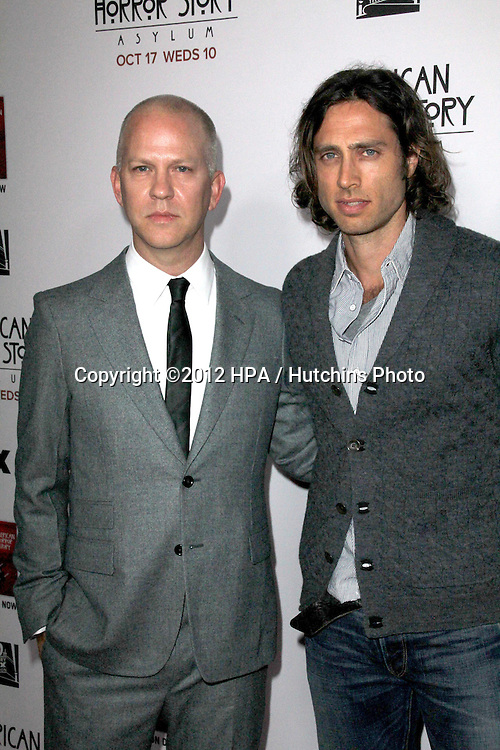 """LOS ANGELES - OCT 13:  Ryan Murphy, Brad Flachuk arrives at the """"American Horror Story: Asylum"""" Premiere Screening at Paramount Theater on October 13, 2012 in Los Angeles, CA"""
