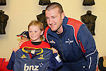 NELSON, NEW ZEALAND - July 26: Alex Ainley with a young Makosnand Highlanders fan during the Tasman Makos Family Fun Day at TRU Players Room, Trafalga Park July 26, 2015 in Nelson, New Zealand. (Photo by Marc Palmano/Shuttersport Limited)