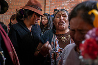 Relatives and friends mourn during a funeral of six people killed during clashes between supporters of former Bolivian President Evo Morales with security forces, at the San Francisco de Asis church in El Alto, on the outskirts of La Paz, Bolivia. At least nine people were killed in clashes outside a major fuel depot in Senkata, 40km from La Paz, that had been blockaded for days. November 20, 2019.<br /> Des proches et des amis pleurent les funérailles de six personnes tuées lors d'affrontements entre des partisans de l'ancien président bolivien Evo Morales et les forces de sécurité, à l'église San Francisco de Asis à El Alto, dans la banlieue de La Paz, en Bolivie. Au moins neuf personnes ont été tuées dans des affrontements devant un important dépôt de carburant à Senkata, à 40 km de La Paz, qui avait été bloqué pendant des jours. 20 novembre 2019.