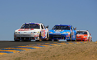 Jun. 21, 2009; Sonoma, CA, USA; NASCAR Sprint Cup Series driver Bobby Labonte (96) leads Martin Truex Jr (1) during the SaveMart 350 at Infineon Raceway. Mandatory Credit: Mark J. Rebilas-