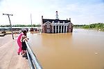 8/12/11} Vicksburg} -- Vicksburg, MS, U.S.A. --Mari Miller Theobald 6, and her mother Lindsey check out the flood waters in downtown Vicksburg s the water fills the old Yazoo Mississippi Valley RailRoad Station. Mrs. Theobald tries to explain to her daughter Marithat this she is seeing history in the making, this flood is worse than the 1927 flood. Members of The Corp of Engineering and Col. Eckstein hold a press conference on the Yazoo backwater levee, detailing how they are trying to contain the flood water from the Mississippi River from flooding over 1.2 million acres of farm land and damaging thousands of homes and disrupting thousands of people. Vicksburg a riverfront town steeped in war and sacrifice, gets set to battle an age-old companion: the Mississippi River. The city that fell to Ulysses S. Grant and the Union Army after a painful siege in 1863 is marshalling a modern flood-control arsenal to keep the swollen Mississippi from overwhelming its defenses. PHOTO©SUZIALTMAN.COM.Photo by Suzi Altman, Freelance.