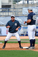 Staten Island Yankees manager Jody Reed (2) talks with firstbaseman Kyle Roller (48) during first team workout at Richmond County Bank Ballpark at St. George in Staten Island, NY June 15, 2010.  Photo By Tomasso DeRosa/ Four Seam Images
