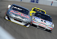 Mar. 6, 2011; Las Vegas, NV, USA; NASCAR Sprint Cup Series driver Brian Vickers (left) races alongside Tony Stewart during the Kobalt Tools 400 at Las Vegas Motor Speedway. Mandatory Credit: Mark J. Rebilas-