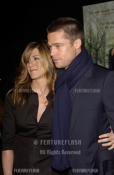 Actress JENNIFER ANISTON & husband actor BRAD PITT at the world premiere, in Hollywood, of her new movie Along Came Polly..January 12, 2004