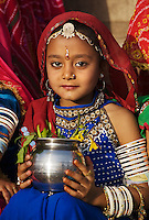 A Rajasthani girl dressed in her finest clothing and jewelry to celebrate the GANGUR FESTIVAL also know as the MEWAR FESTIVAL - UDAIPUR, RAJASTHAN, INDIA