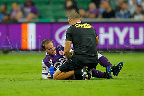 25th March 2018, nib Stadium, Perth, Australia; A League football, Perth Glory versus Melbourne Victory; Neil Kilkenny of Perth Glory gets treatment during the second half