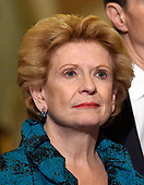 United States Senator Debbie Stabenow (Democrat of Michigan) listens as US Senate Minority Leader Chuck Schumer (Democrat of New York) speaks to reporters outside the US Senate Chamber following the Democrats' weekly luncheon caucus in the US Capitol in Washington, DC on Tuesday, September 19, 2017.  The Democratic leadership is advocating against the passage of the Graham-Cassidy Act that would replace parts of the Affordable Care Act (also known as ObamaCare) with block grants for the individual states.<br /> Credit: Ron Sachs / CNP