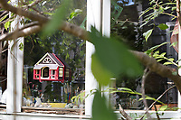 """One of Jada Fitch's """"Home Tweet Home"""" birdhouses hangs on a window to her living room, which also doubles as her art studio, in Portland, Maine, USA, on Fri., July 28, 2017. The birdhouses have become so popular that they sell out in minutes on her Etsy web shop."""