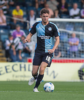 Danny Rowe of Wycombe Wanderers in action during the Sky Bet League 2 match between Wycombe Wanderers and Plymouth Argyle at Adams Park, High Wycombe, England on 12 September 2015. Photo by Andy Rowland.