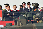 October 23, 2016, Asaka, Japan - Japanese Prime Minister Shinzo Abe in formal attire reviews the grand parade of tanks, armored vehicles and ground troops during an annual Armed Forces Day celebration in honor of Japans defense forces at the Ground Self-Forces parade ground in Asaka, outside of Tokyo, on Sunday, October 23, 2016. (Photo by Natsuki Sakai/AFLO) AYF -mis-