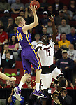 Northern Iowa State's Nate Buss (14) shoots over  Louisville's Mangok Mathiang (12)  during the 2015 NCAA Division I Men's Basketball Championship's March 22, 2015 at the Key Arena in Seattle, Washington.  Louisville beat Northern Iowa State 66-53 to advance to the Sweet 16.  ©2015. Jim Bryant Photo. ALL RIGHTS RESERVED.