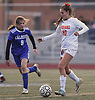 Olivia Dooley #10 of Manhasset, right, gets pressured by Ava Bayay #9 of Calhoun during a Nassau County Conference AB1 varsity girls soccer game at Calhoun High School on Tuesday, Oct. 16, 2018. The match, which was called with 9:57 remaining due to darkness, ended in a 1-1 tie.