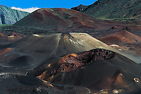 The bottomless pit cinder cone, also referred to as Pele's Paint Pot represents their massive scale in HALEAKALA NATIONAL PARK on Maui in Hawaii