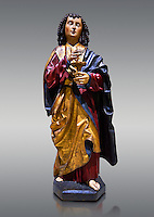 Gothic wooden statue of Sant Joan Evangelista (John the Evangelist) from Gremany, circa 1500, tempera and gold leaf on wood.  National Museum of Catalan Art, Barcelona, Spain, inv no: MNAC  64114. Against a light grey background.