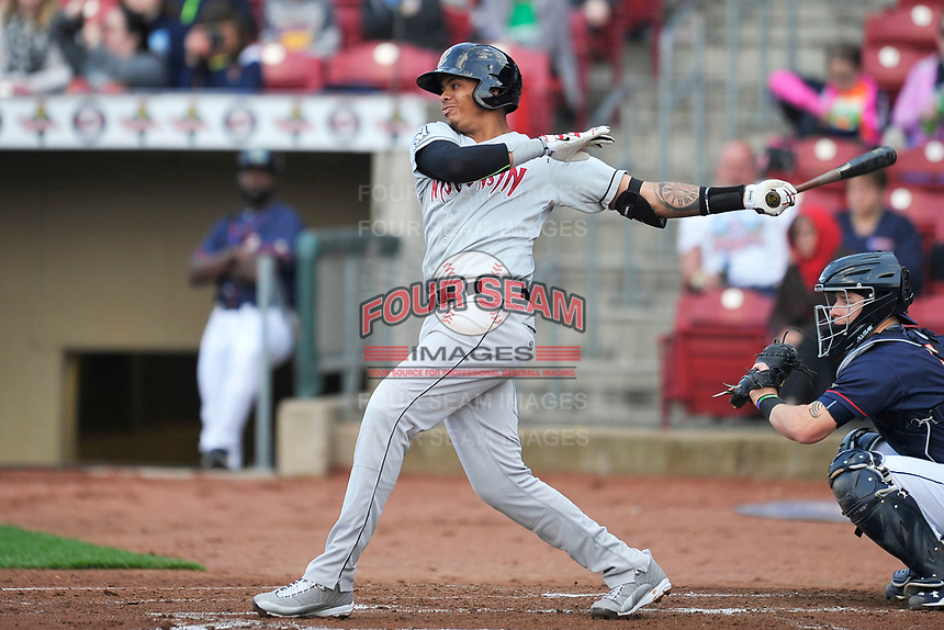 Wisconsin Timber Rattlers third baseman Gilbert Lara (11) swings during a game against the Cedar Rapids Kernels at Veterans Memorial Stadium on April 13, 2017 in Cedar Rapids, Iowa.  The Kernels won 2-1.  (Dennis Hubbard/Four Seam Images)