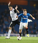 Lewis Macleod ghosts past Greg Tansey