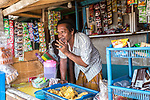 13 August 2019, Jakarta, Indonesia: Shopkeeper Udin Slamet (45) has lived in Muara Baru for 40 years and tells of having to flee to friends second story homes to escape the ocean.The protective seawall barrier keeping the ocean at bay at Muara Baru, North Jakarta was built by Governor (now President) Joko Widodo  constructed to prevent further encroachment by the ocean into the settlements in North Jakarta which is sinking at a rate faster than anywhere else in the world. Residents speak of the flooding  that would drive them to higher ground washing away all in its path. Residents now say the land is dry and usable but it is an ongoing crisis for Indonesia. Picture by Graham Crouch/The Telegraph