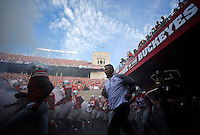 Ohio State Buckeyes head coach Urban Meyer brings his team onto the field before Saturday's NCAA Division I football game against Cincinnati at Ohio Stadium in Columbus on September 27, 2014. (Columbus Dispatch photo by Jonathan Quilter)
