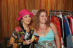 fan Janell poses with Robin Strasser of One Life To Live at an in-store appearance on August 16, 2009 at Housing Works Upper East Side Thrift Shop, New York City, New York. Robin donated a full rack of clothes and truckload of furniture to Housing Works and fans came to see and buy many many of  the items ranging from her great variety of clothes, jewelry, hats, furniture, backpacks and other items. This way the fans have momentos and wearables of Robin Strassers while donating to Housing Works. (Photo by Sue Coflin/Max Photos)