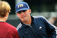 11 February 2012:  FIU Head Coach Jake Schumann speaks with UMass Head Coach Elaine Sortino prior to the start of the game.  The University of Massachusetts Minutewomen defeated the FIU Golden Panthers, 3-1, as part of the COMBAT Classic Tournament at the FIU Softball Complex in Miami, Florida.