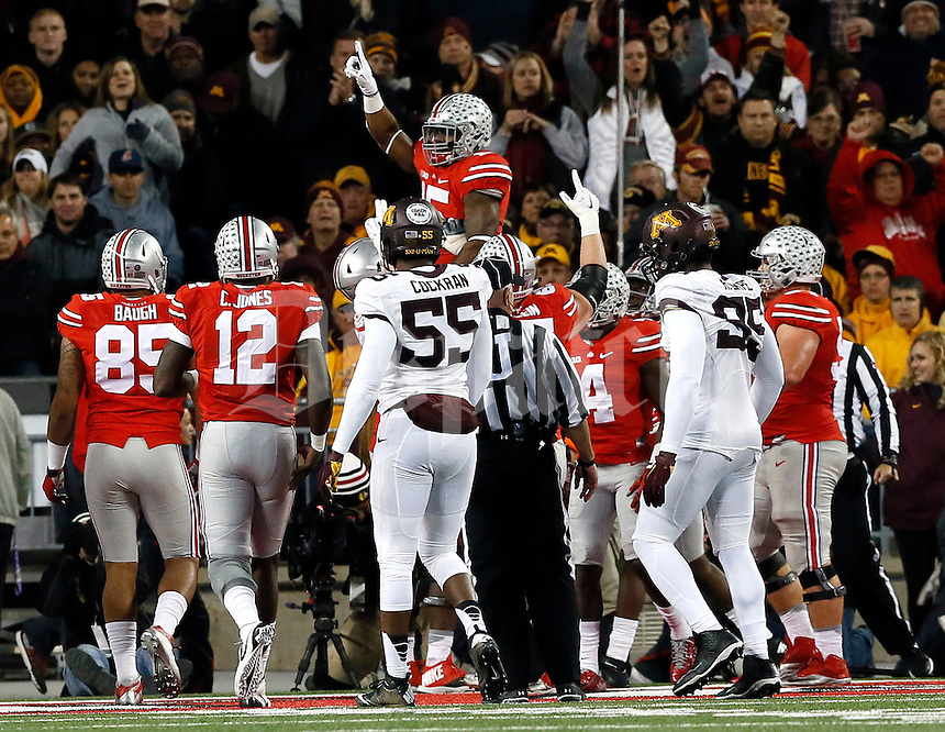 Ohio State Buckeyes running back Ezekiel Elliott (15) is lifted by teammates after scoring a touchdown in the first half of their game at Ohio Stadium in Columbus, Ohio on November 7, 2015. (Columbus Dispatch photo by Brooke LaValley)