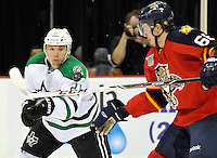 Dallas Stars' Antoine Roussel, left, and Florida Panthers' Logan Shaw chase the puck during the second period of an NHL preseason hockey game, Friday, Sept. 20, 2013, in San Antonio, Texas. (Darren Abate/DA Media)